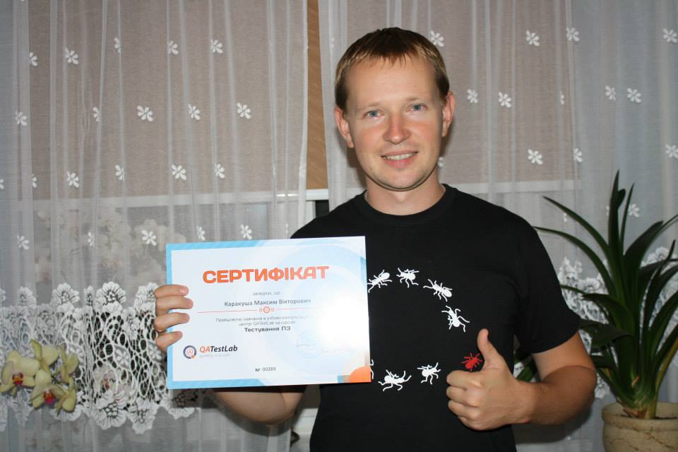 QATestLab training graduate with certificate